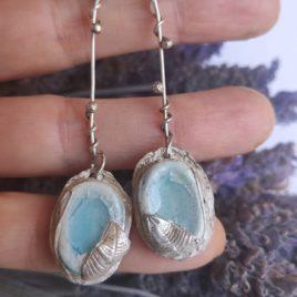 Pendientes Aguamarina con hojas de plata en mano 1